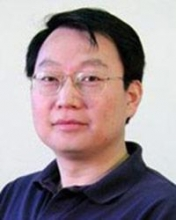 Headshot of Hongyuan Zha on white background in a dark blue shirt