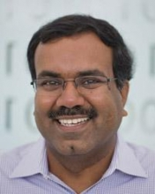 Headshot of Srinivas Aluru with glasses on and purple shirt